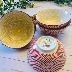 Red and yellow set of 4 ceramic patterned bowls